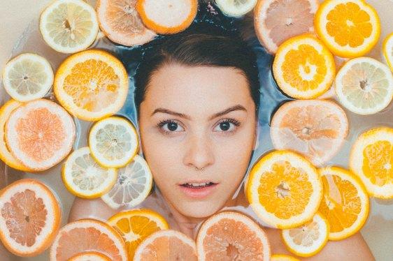 photo of a woman in a bath of lemons
