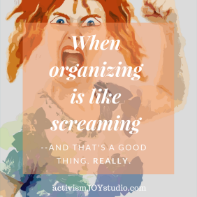 red-haired woman screaming and raising her fist